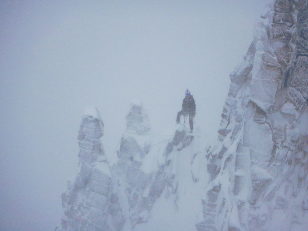 A photo of me stood on the col just after the fingers in pretty bad weather. Photo by Will.