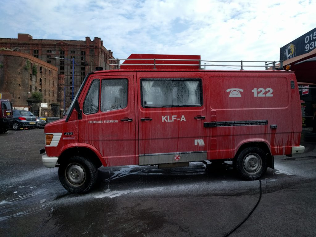 The fire engine being washed before dropping it off in the port.