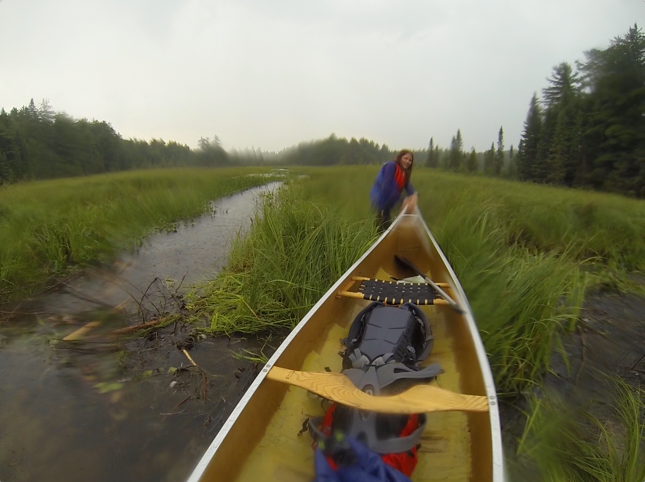 Janneke pulling the canoe past one of the many beaver dams along the way...